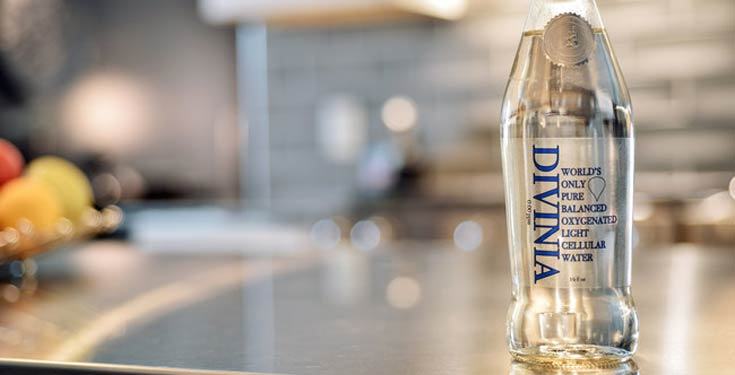 Divinia water bottle on counter