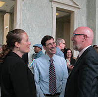 Making progress – Mike Jawer (center), director of government and public affairs for the American Association of Naturopathic Physicians, consults with Bastyr University student Elizabeth Yori and David Macallan, ND, at the 2013 DC FLI event in Washington, D.C.