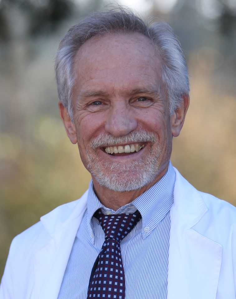 Dr. Peterson in his white coat