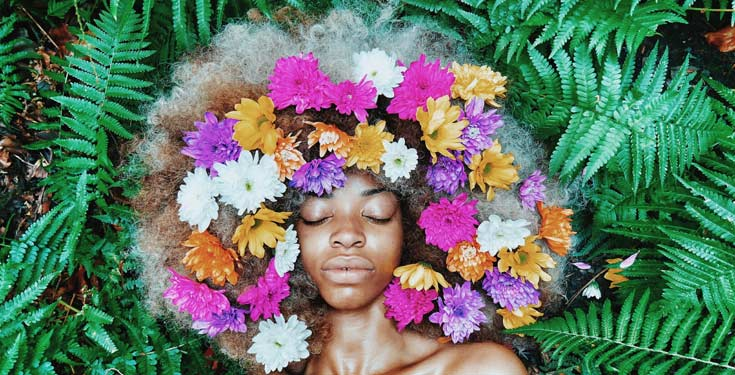 black woman with flowers in her hair
