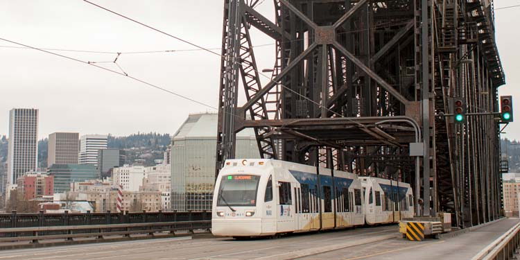 Max train going across bridge in Portland, Oregon